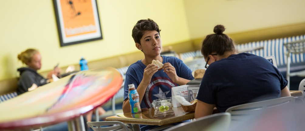 Two students eat at the Lair, Loyola Marymount University's main dining hall.