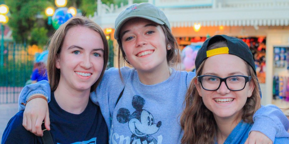 Three Loyola Marymount University pre-college students pose during a trip to Disneyland.