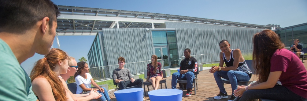 A group of students sit on the rooftop deck above the Life Science building at Loyola Marymount University.