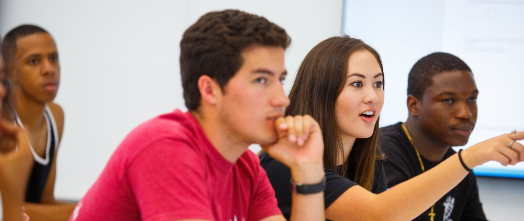 Three students participate in a classroom discussion at Loyola Marymount University.