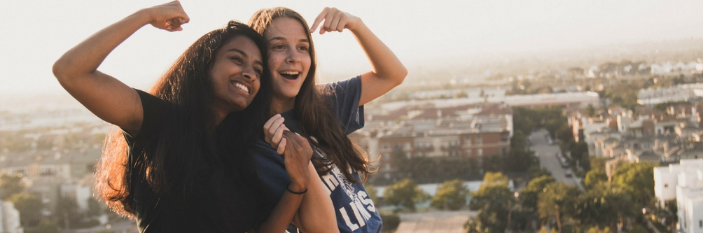 Two Loyola Marymount University students pose for a photo on the LMU bluff.